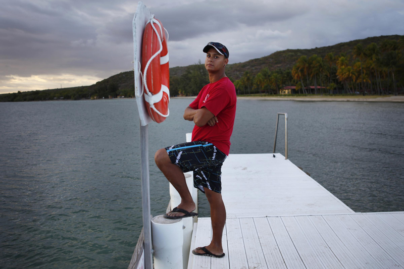 """Edward Bonet, 23, lives in Cabo Rojo, Puerto Rico, and works on the dive team at the Copamarina Beach Resort & Spa in the town of Guanica. He lives with his grandmother, Genoveva """"Veva"""" Camacho."""